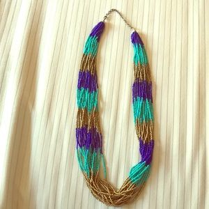 Teal, navy, and gold long beaded necklace